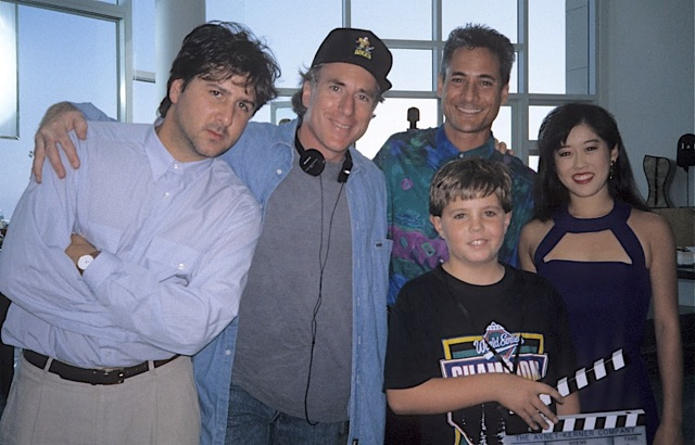 The adults, from left to right (Mighty Ducks creator Steve Brill, D2 director Sam Weisman, Greg Louganis, Kristi Yamaguchi)