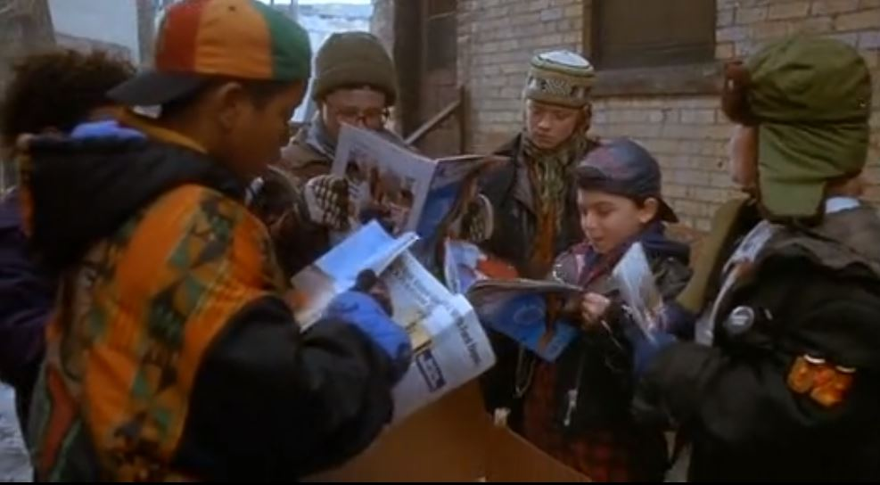 The Mighty Ducks crew huddled around Sports Illustrated swimsuit editions