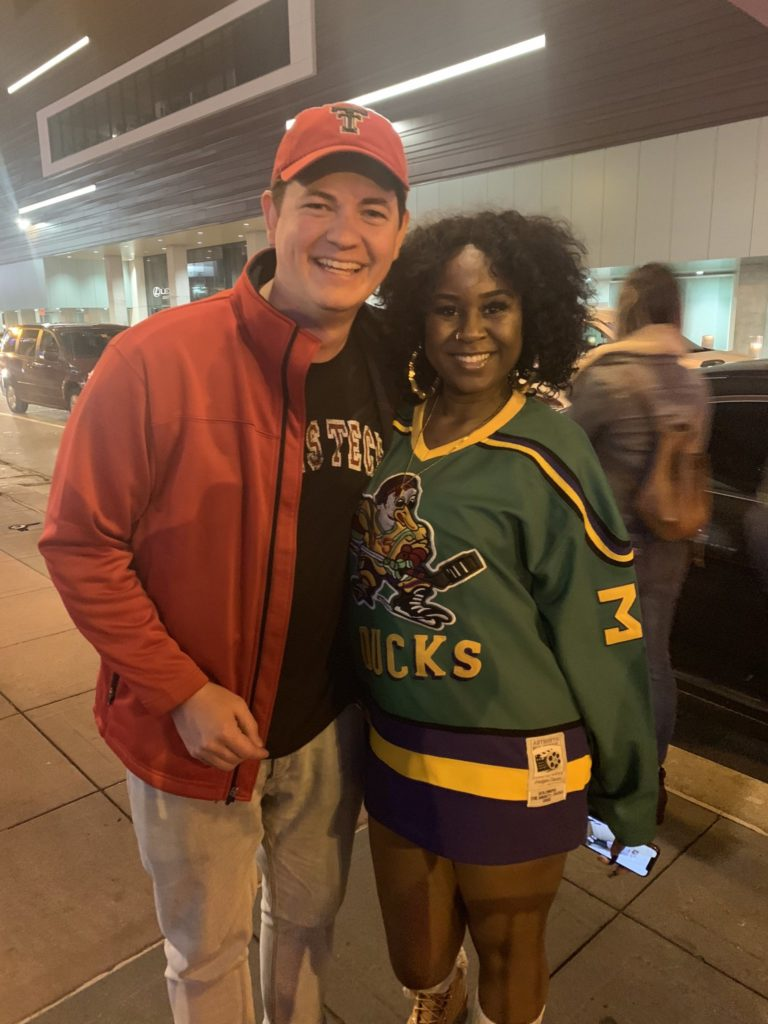 Kevin and a Random woman wearing a Mighty Ducks jersey in Minneapolis